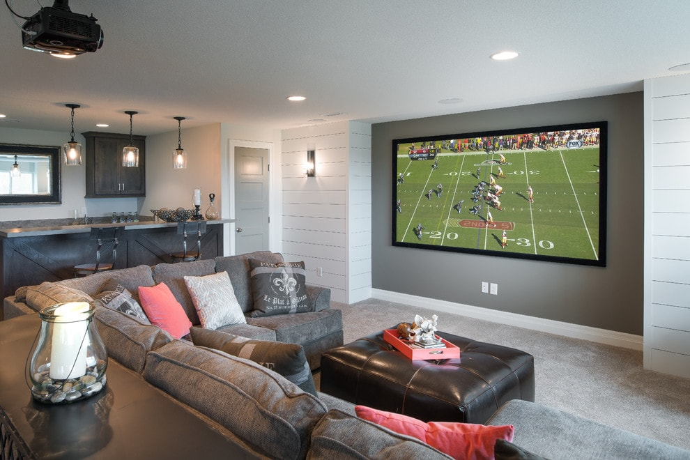 Amazing home theater with a sports theme. #hometheater #mediaroom #theater