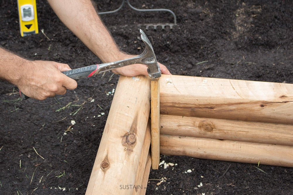 constructing a wood garden bed with wood ties