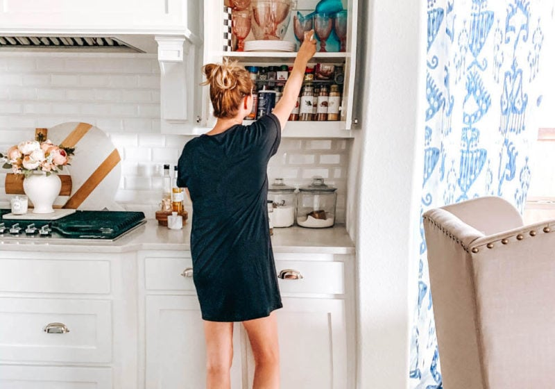 A before and after on how to purge a spice cabinet and the best organization products to use. #spicecabinet #kitchen #organization #ABlissfulNest