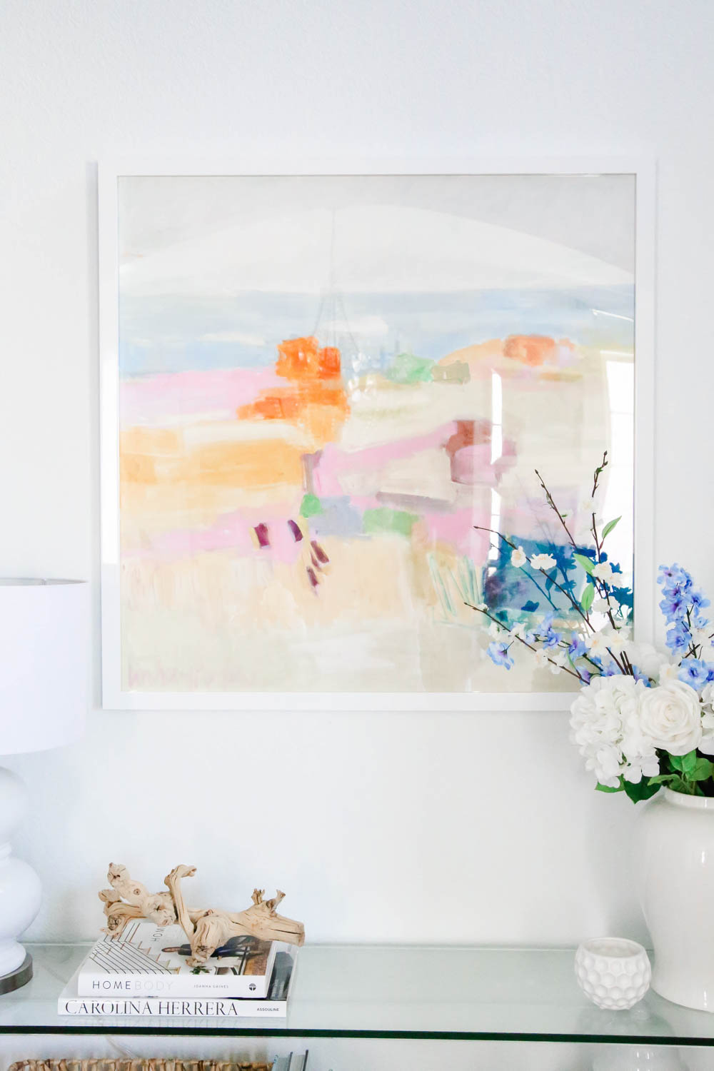 A colorful piece of art transforms this entryway for summer. #summerdecor #entryway #ABlissfulNest