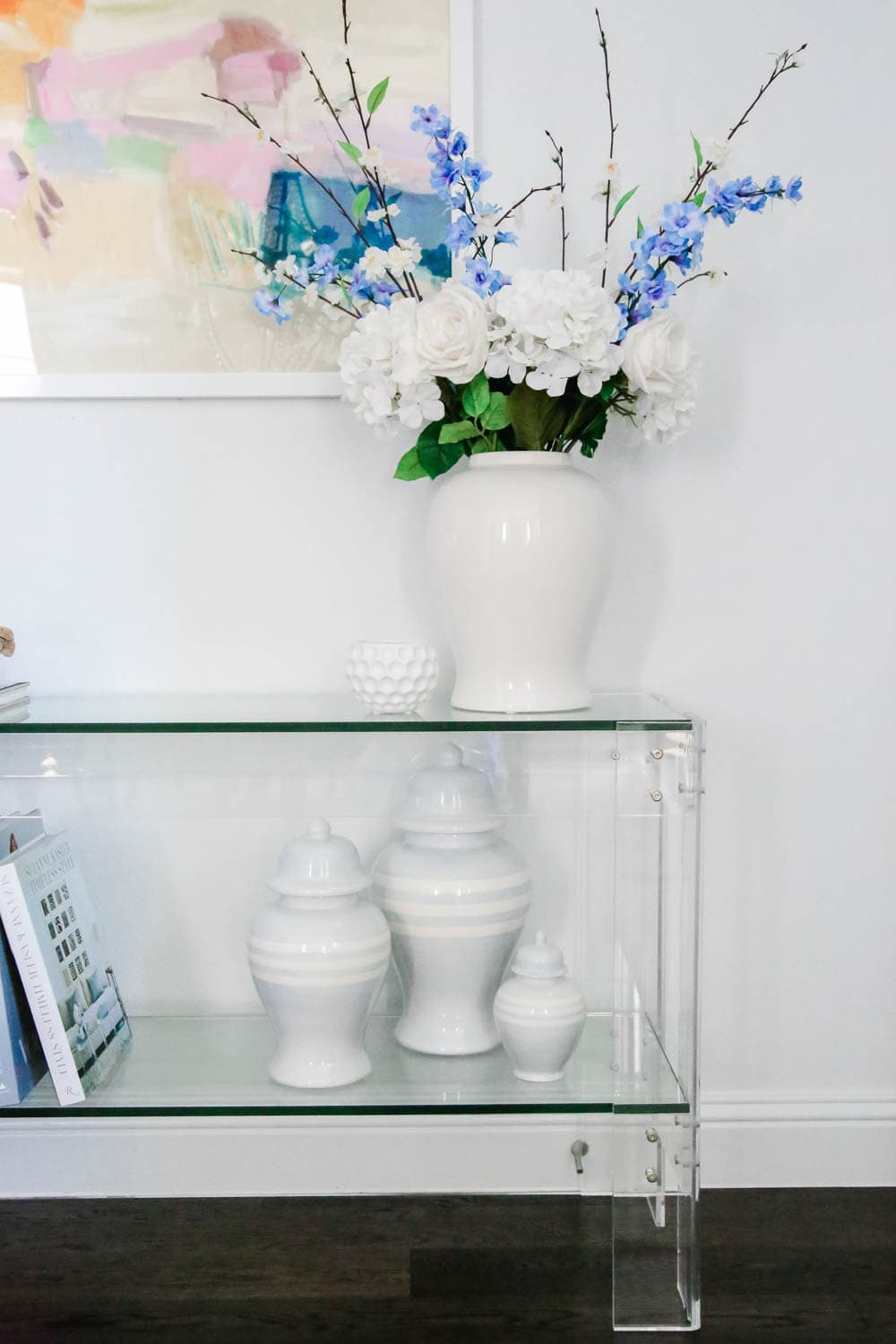 Ginger jars, faux florals, modern art, lucite table, entryway decor. #entryway #summerdecor #ABlissfulNest