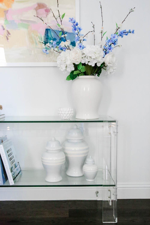 Ginger jars, faux florals, modern art, lucite table, entryway decor. #entryway #summerdecor #ABlissfulNest
