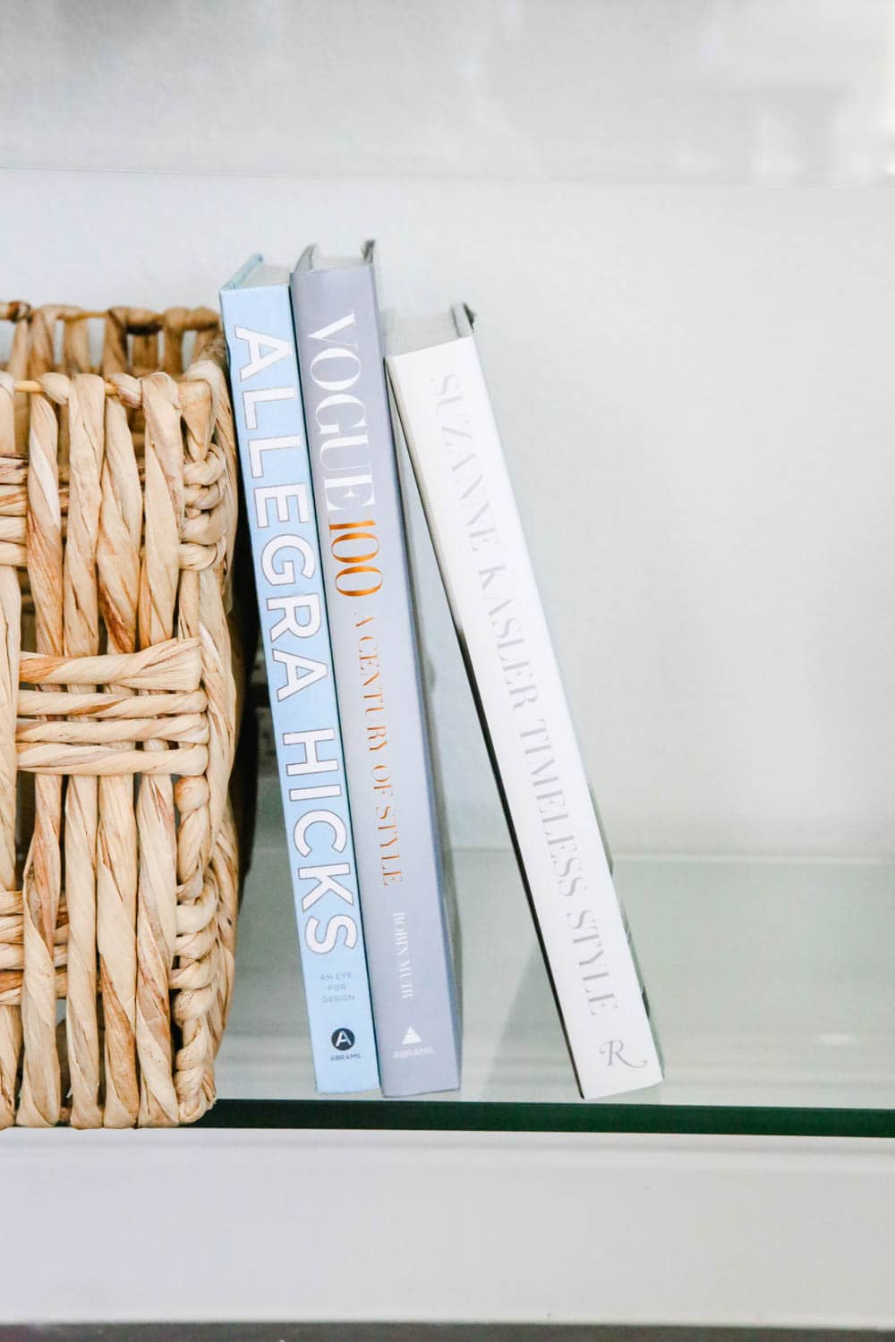 Coffee table books stacked on a entryway table. #entryway #summerdecor #ABlissfulNest