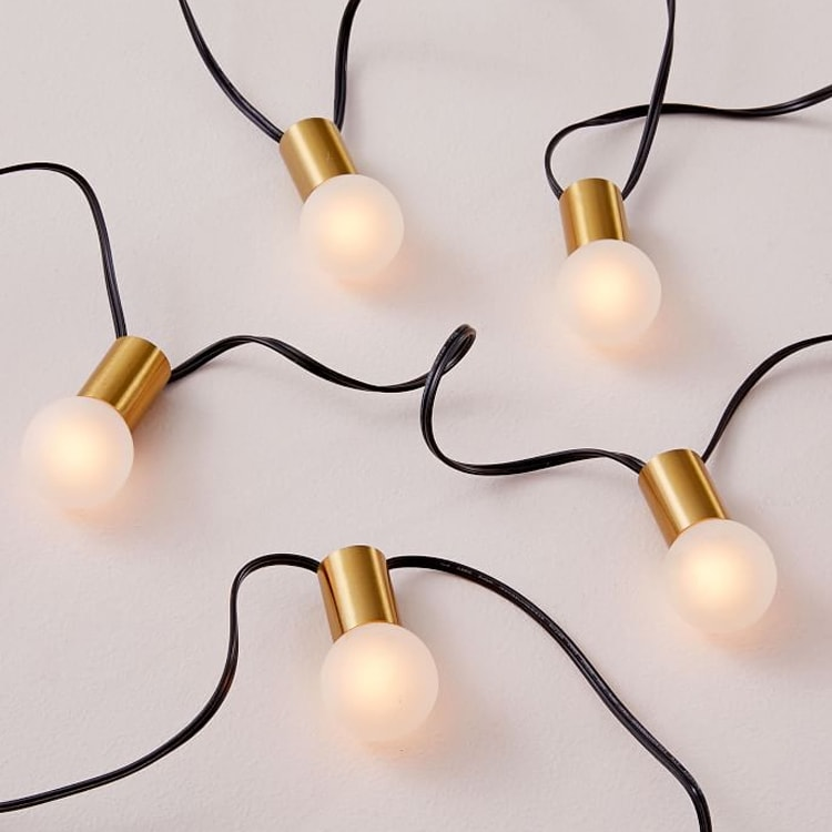 These string lights are a perfect addition to your patio to add some extra lighting this season! #ABlissfulNest