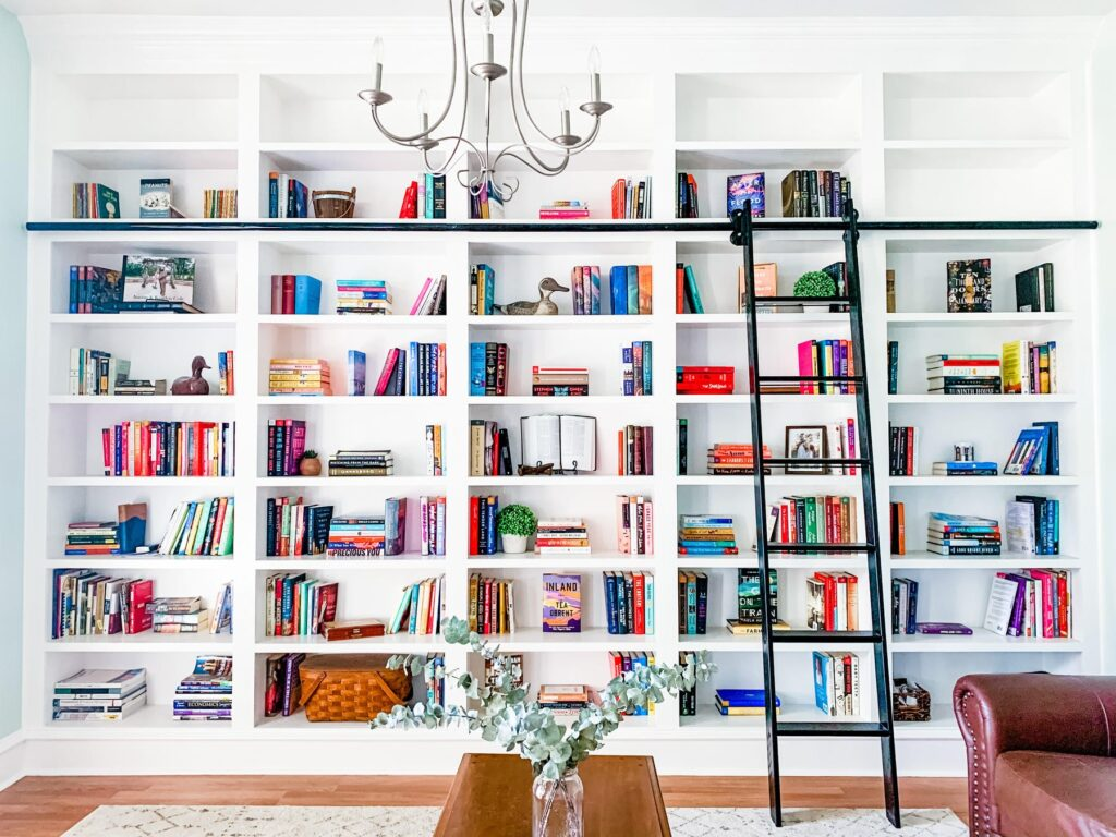 Chic wall of bookshelves filled with notebooks, books, and school supplies