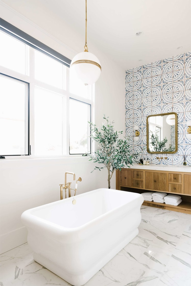 The most beautiful wallpaper embellished bathroom by House of Jade Interiors!