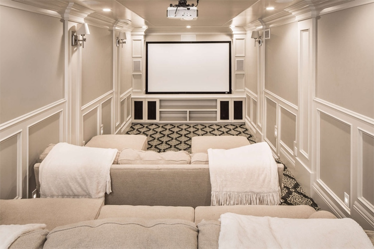 This home theater by The Fox Group is such a perfect family space!