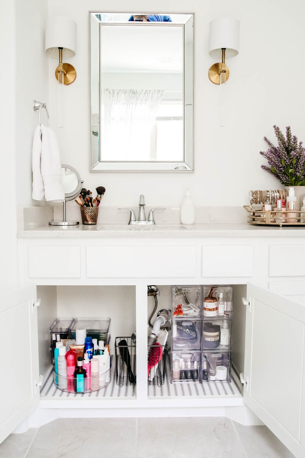 An easy hack to organize your bathroom cabinets and make them easy to clean + maintain to keep the clutter away.