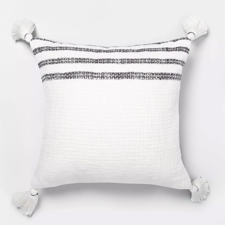 This striped tassel pillow is a perfect addition to your home! #ABlissfulNest