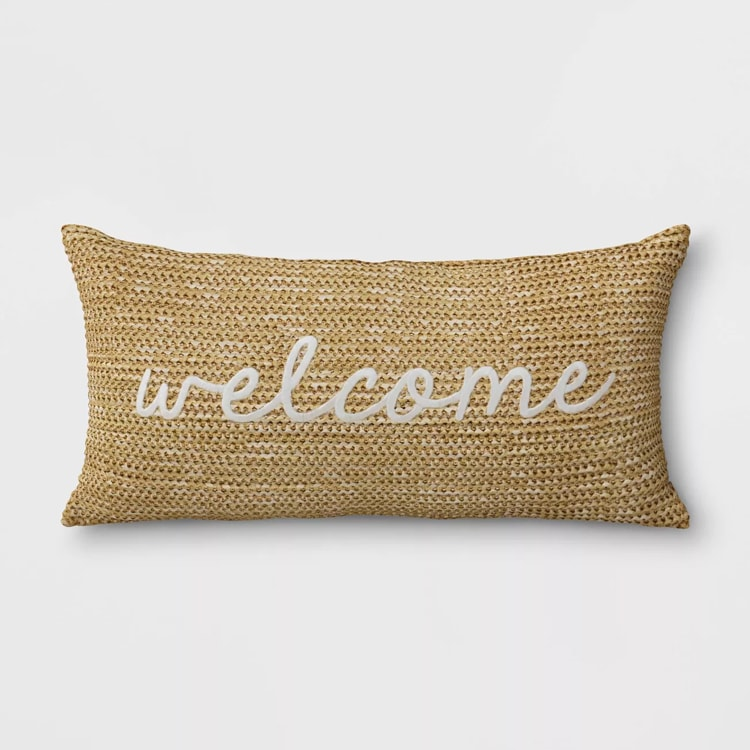 The prettiest woven 'welcome' pillow to add to your decor outdoors OR indoors this year! #ABlissfulNest