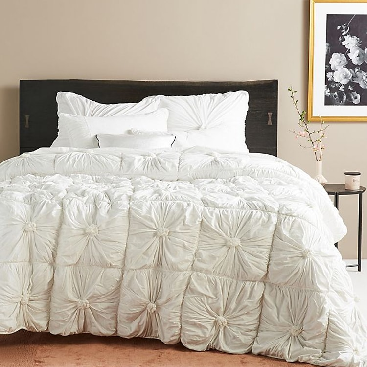 This white quilt set is a stunner! Perfect for any bedroom in your home! #ABlissfulNest