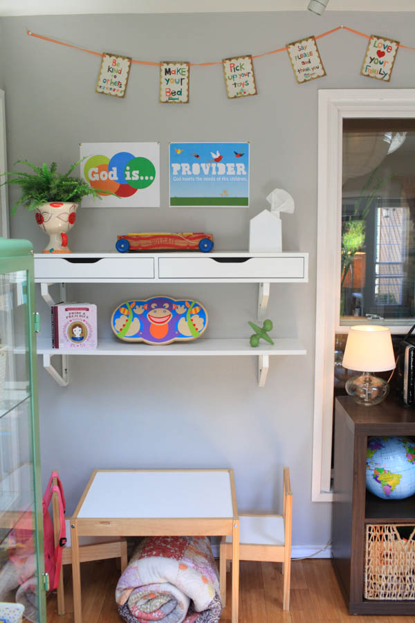 kids table with shelves on the wall