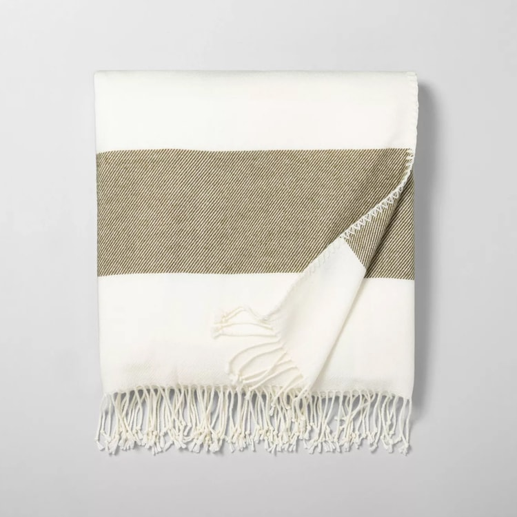 This striped colorblock throw blanket is such a fun piece to add to your home! #ABlissfulNest