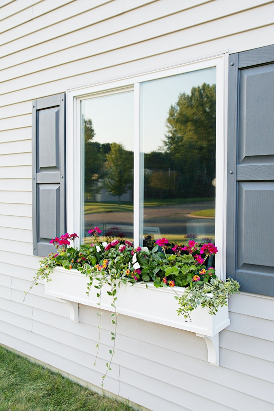 white DIY window planter box filled with plants