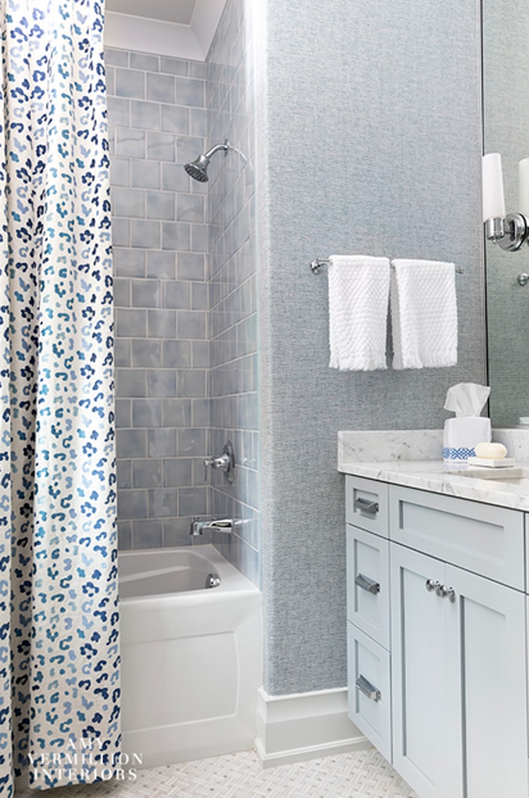 This gorgeous bathroom by Amy Vermillion Interiors is filled with the prettiest shades of gray!