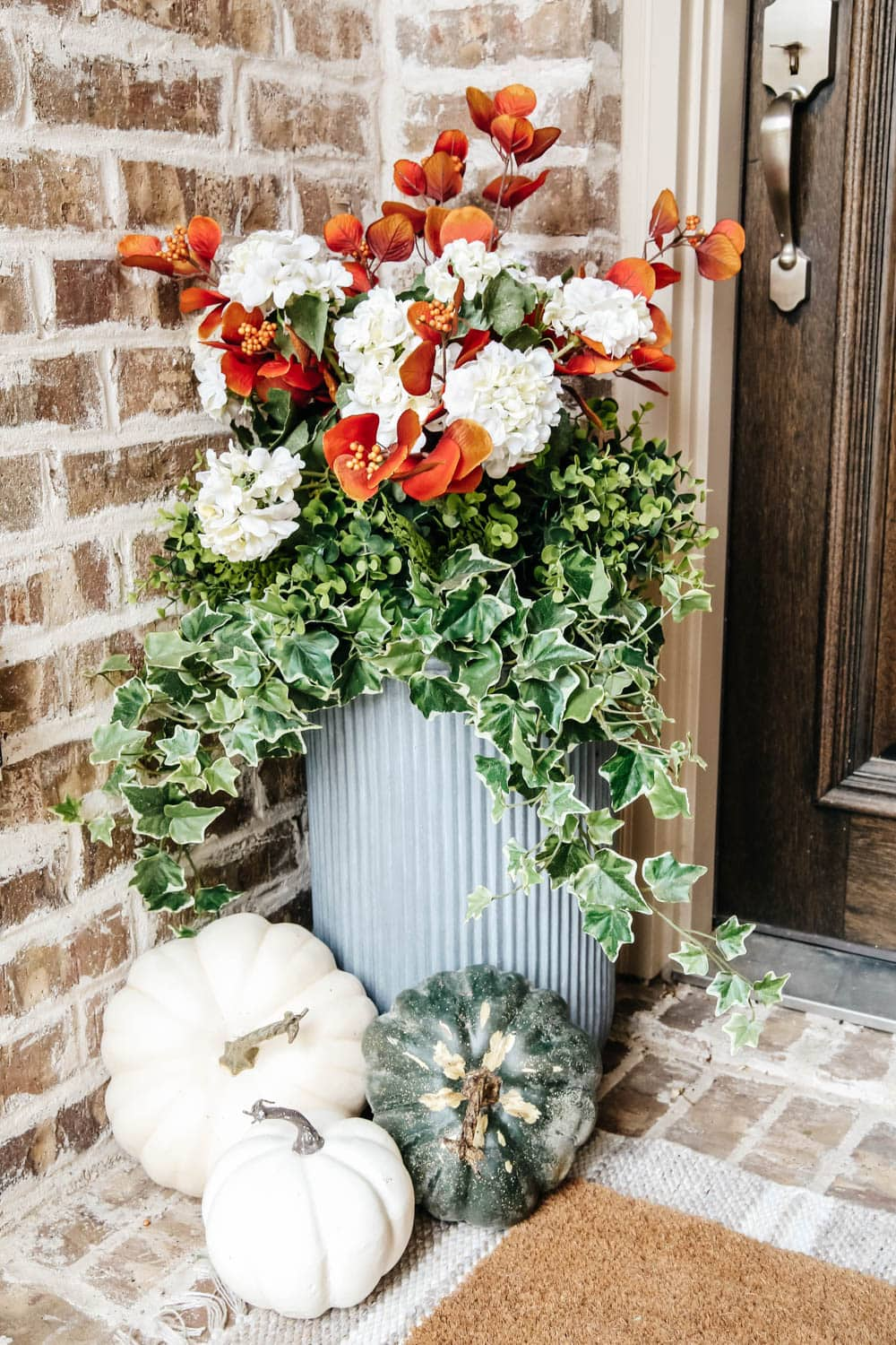 Cluster pumpkins on your porch. #ABlissfulNest #falldecor #fallporch