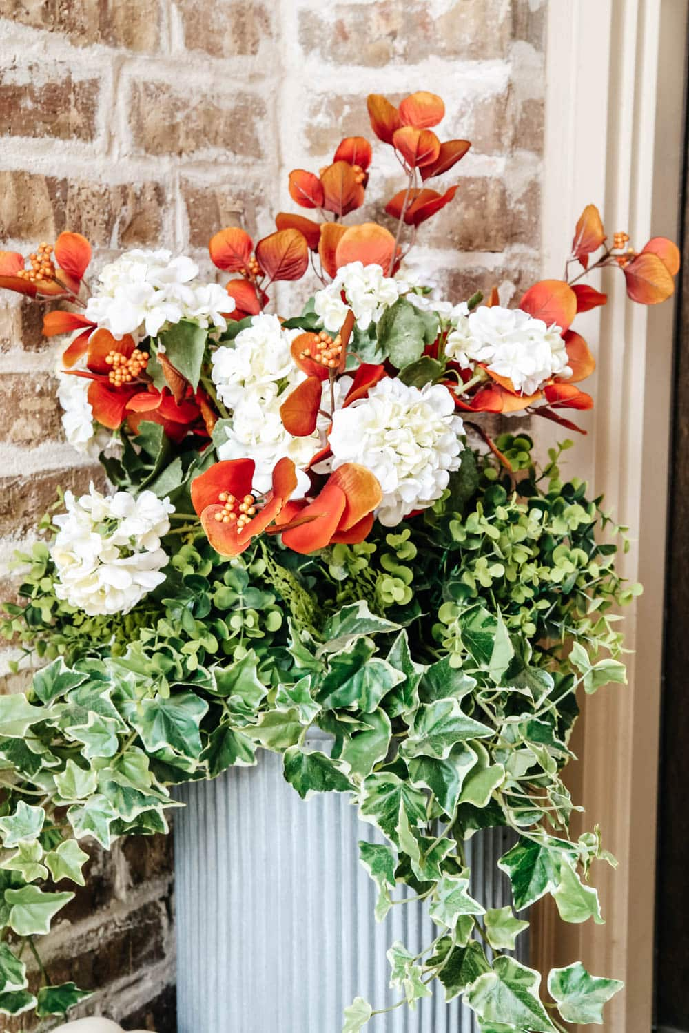 Switch out the flowers in your planters to coordinate with your fall wreath. #ABlissfulNest #fallporch