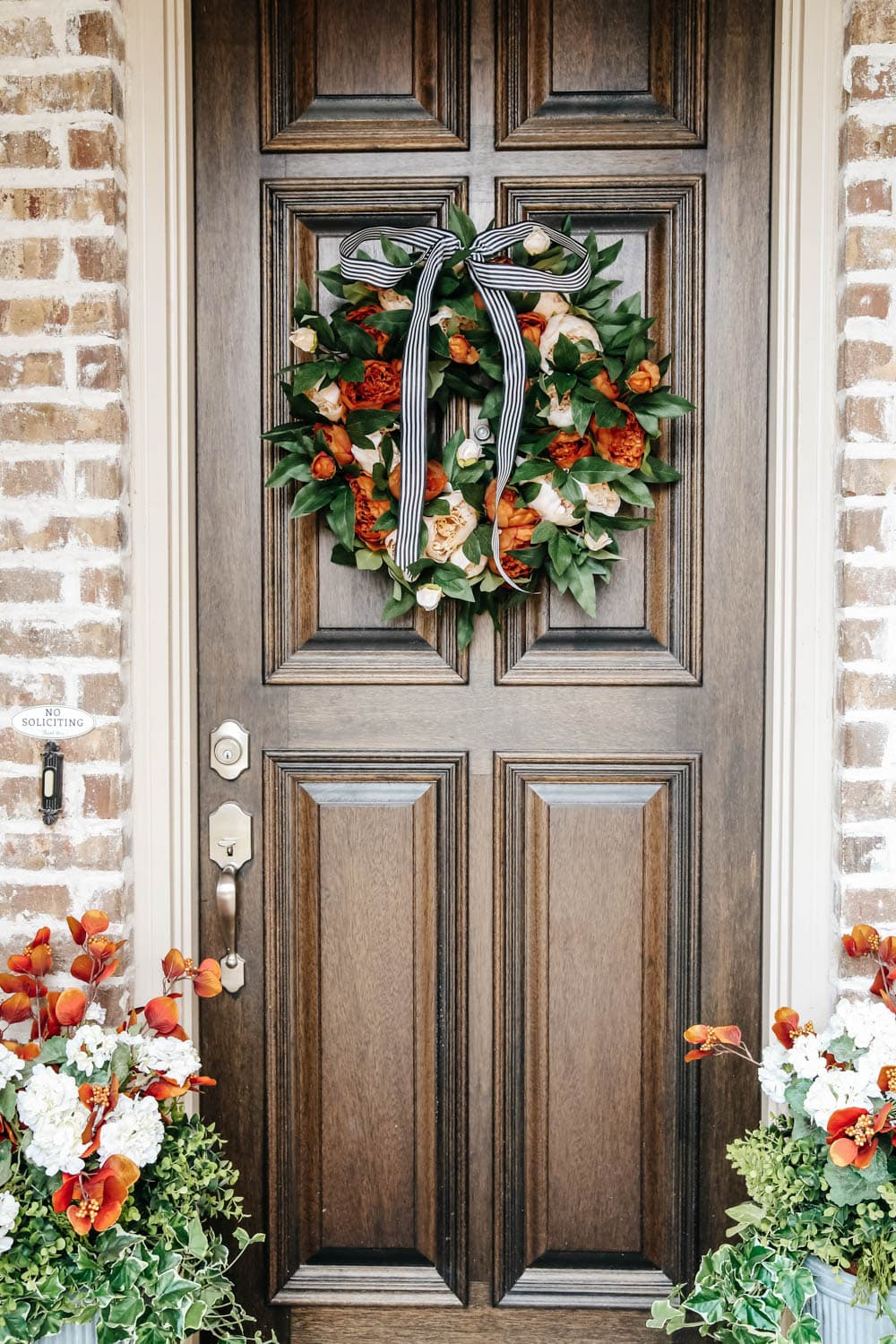 Choose a fall wreath with vibrant colors of the season. #ABlissfulNest #fallporch