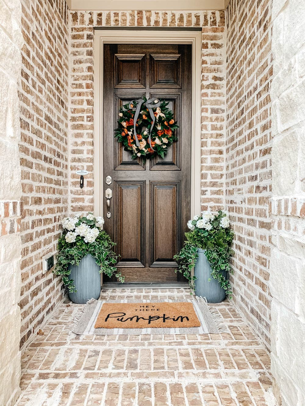 Use a fun welcoming doormat for the season. #ABlissfulNest #falldecor #fallporch