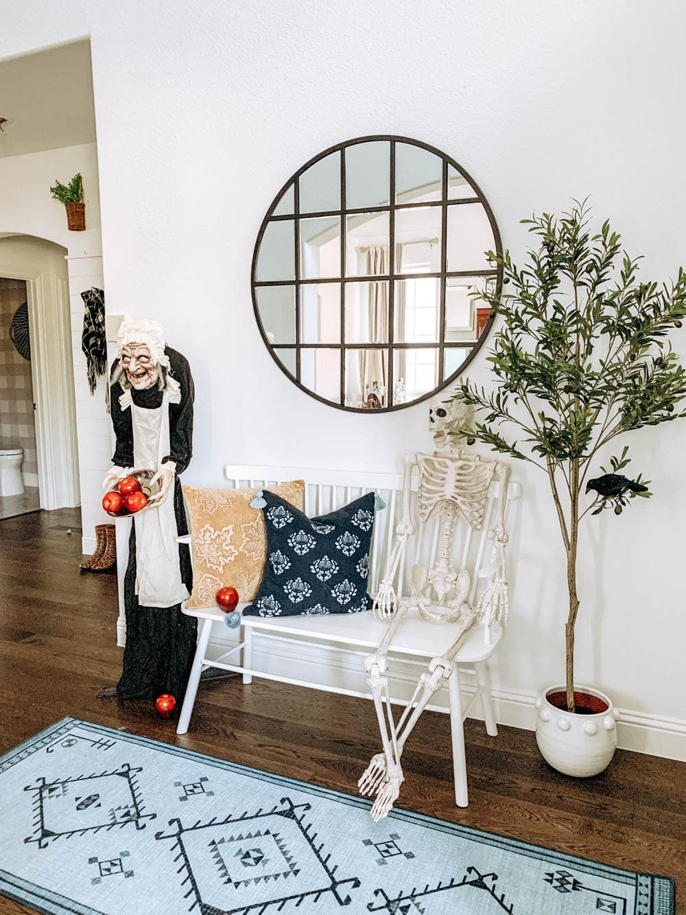 Halloween decor ideas with a talking witch, posable skeleton and birds. #ABlissfulNest #halloweendecor