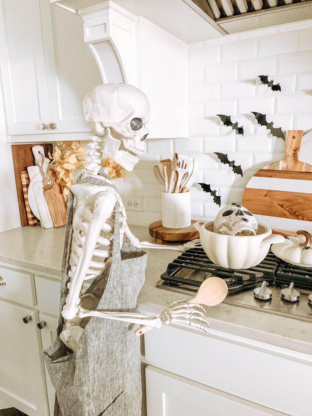 Posable skeleton cooking in a kitchen. Halloween decor ideas. #ABlissfulNest #halloween #halloweendecor