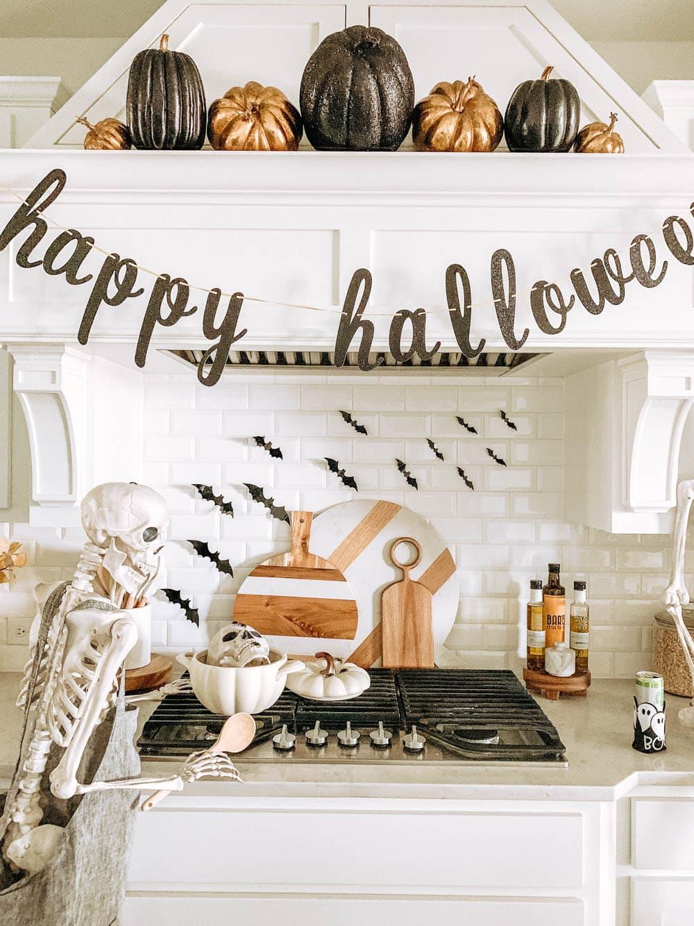 Simple + Easy Halloween decor ideas. Skeletons, pumpkins, flying bats. #ABlissfulNest #halloween #halloweendecor
