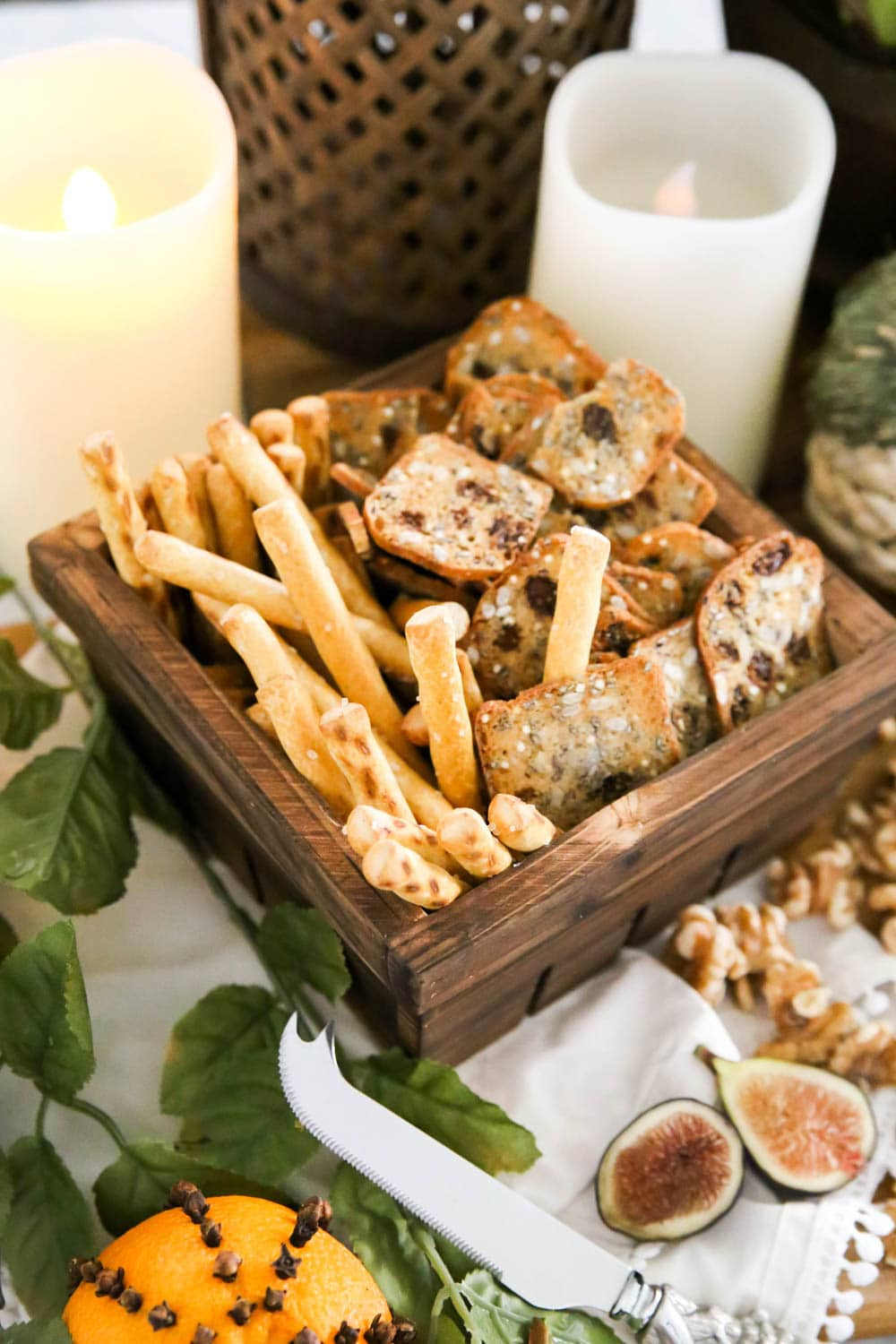 Use baskets to group crackers for a fall cheese board. #ABlissfulNest #fall #ad #RothCheese
