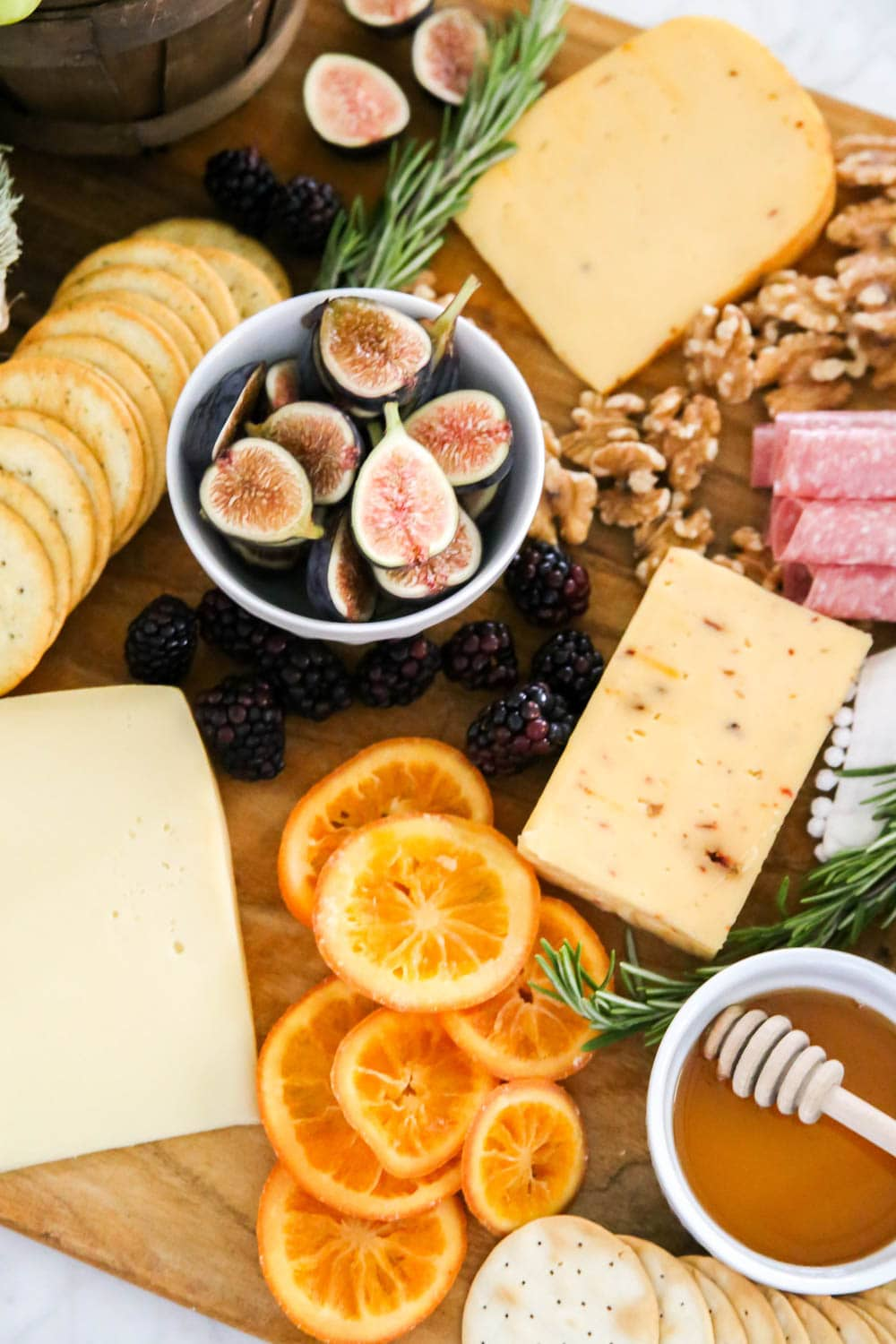 Yummy details on this fall charcuterie board with mixes of fruit, crackers, fresh rosemary and more! #ABlissfulNest #cheeseboard #fall #ad #RothCheese