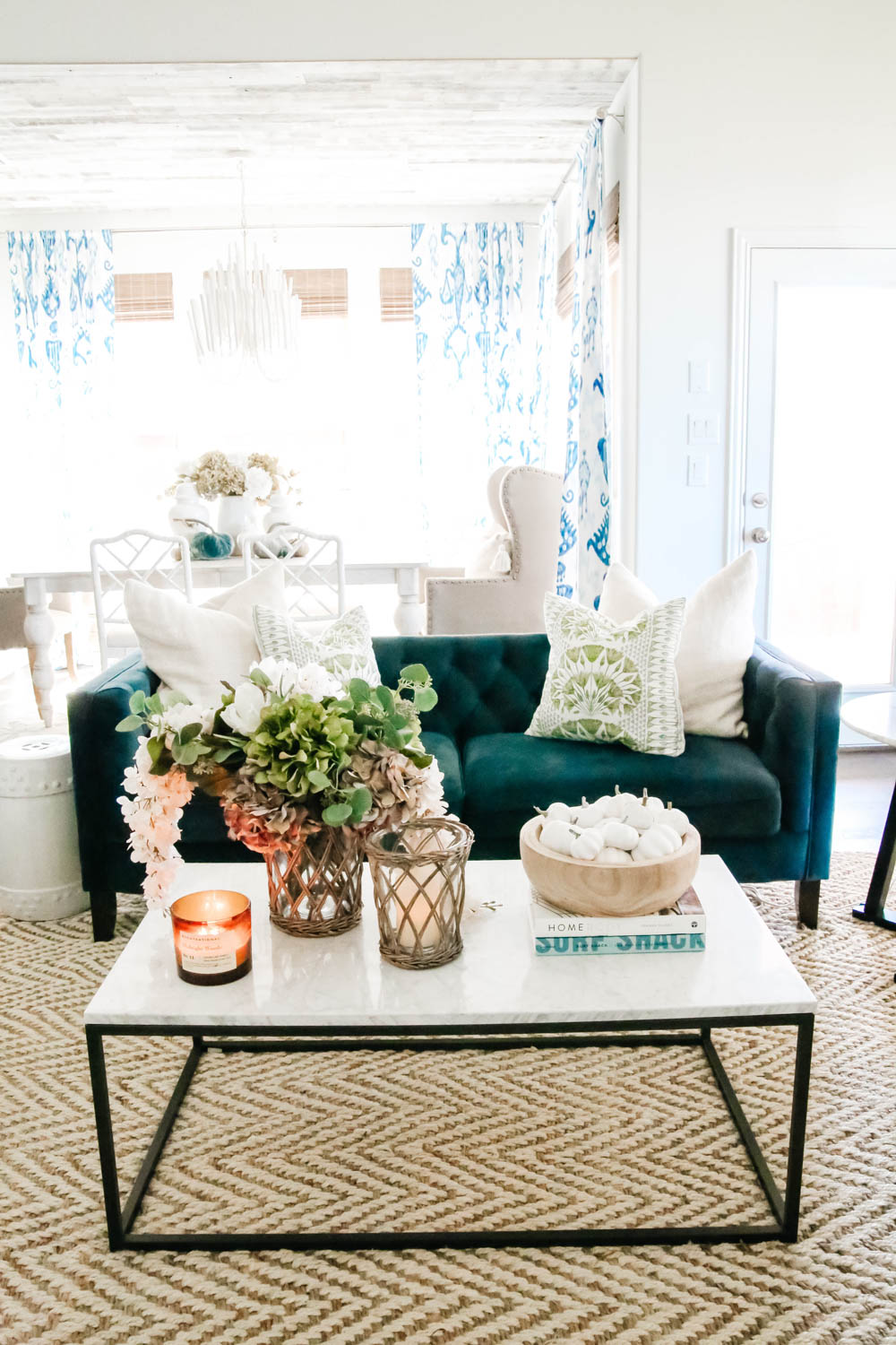 Subtle fall decor accents, blue sofa, marble and iron coffee table, living room. #ABlissfulNest #falldecor #livingroom