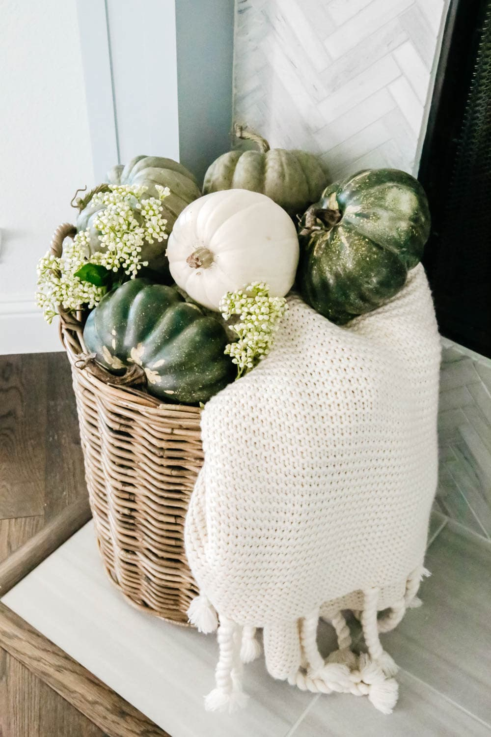 Use baskets for cozy blankets and fall decor accents next to the fireplace. #ABlissfulNest #falldecoratingideas