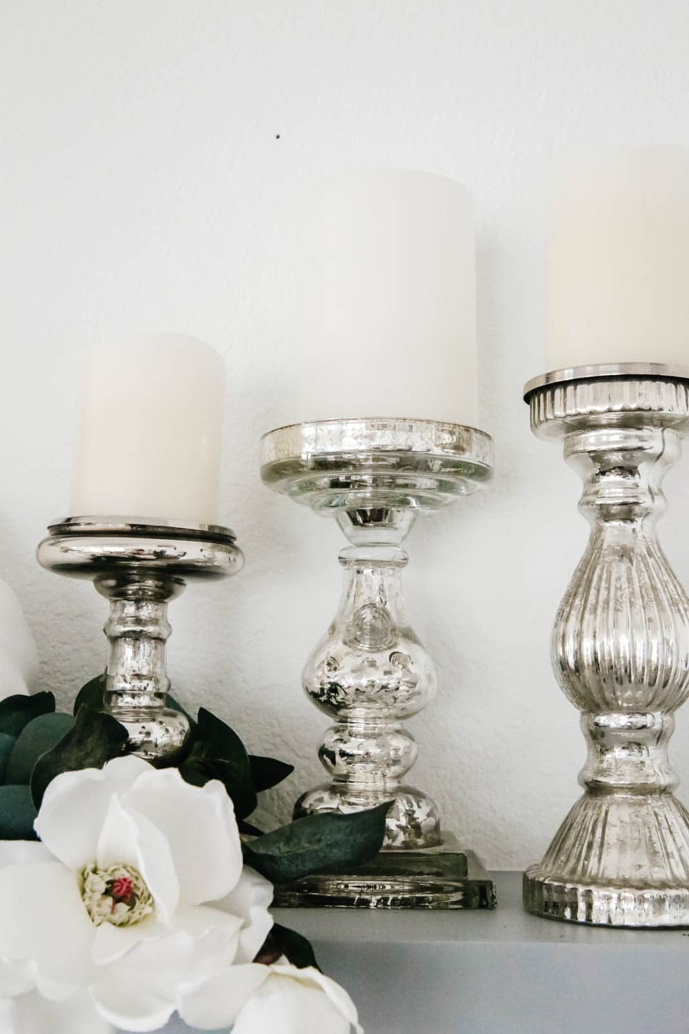 Cluster mercury glass candle holders for a cozy fall vibe. #ABlissfulNest #falldecorideas