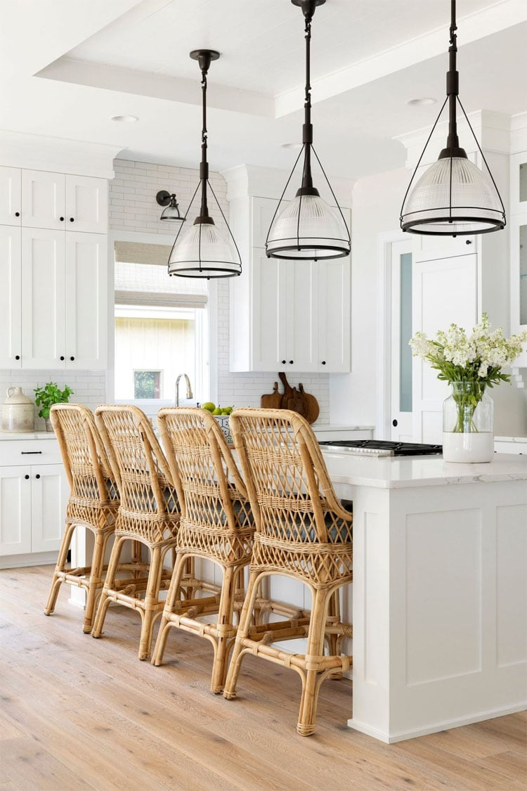 This bright, neutral kitchen designed by Bria Hammel Interiors is so stunning! I love the bar stools and pendant lights!