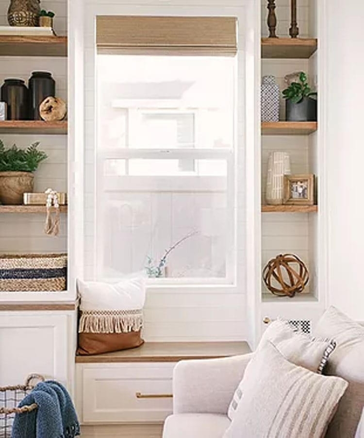 This stunning window seat area by Madison Nicole Designs looks so inviting!