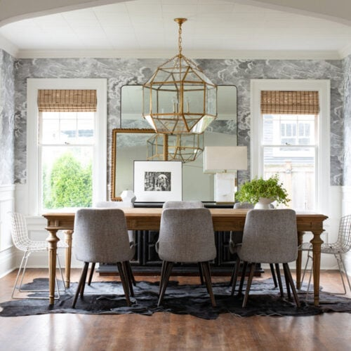 This gorgeous dining space by Kat Lawton Designs has the most beautiful touches of gold to it!