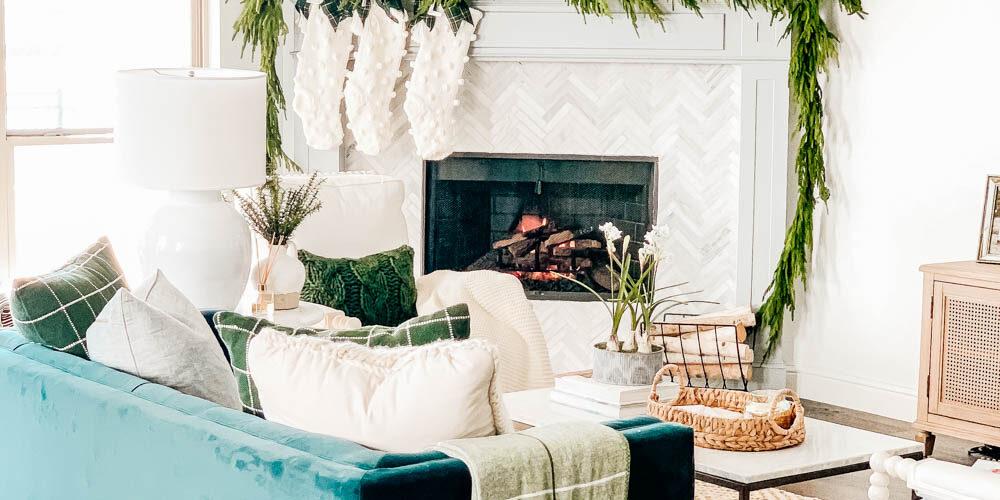 Crisp winter greenery, knit stockings, simple neutral Christmas decor ideas. #ABlissfulNest #christmas #christmasdecor #christmasideas