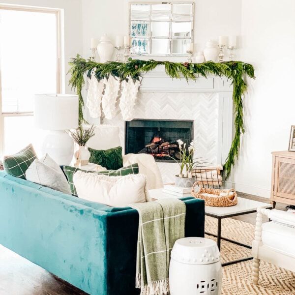 Crisp winter greenery, knit stockings, simple neutral Christmas decor ideas. #ABlissfulNest #christmas #christmasdecor #christmasideas