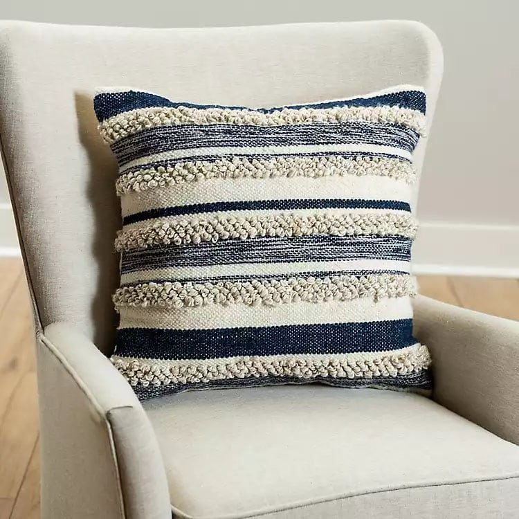 This blue striped tufted throw pillow is a perfect piece to add to your home - it adds so much texture! #ABlissfulNest