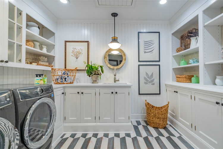This gorgeous laundry room designed by Karen Berkemeyer Interiors is such a stunning space! #ABlissfulNest