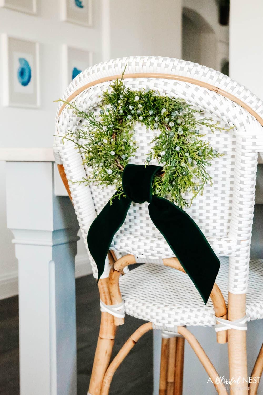 Mini Christmas wreaths on barstools, Christmas kitchen decor ides. #ABlissfulNest #Christmasdecor #Christmasdecorating