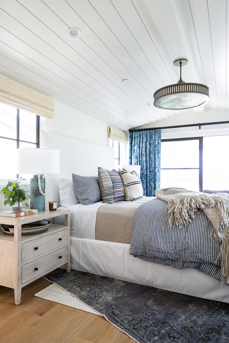 This beautiful bedroom design by Brooke Wagner Design is incredibly bright and inviting!