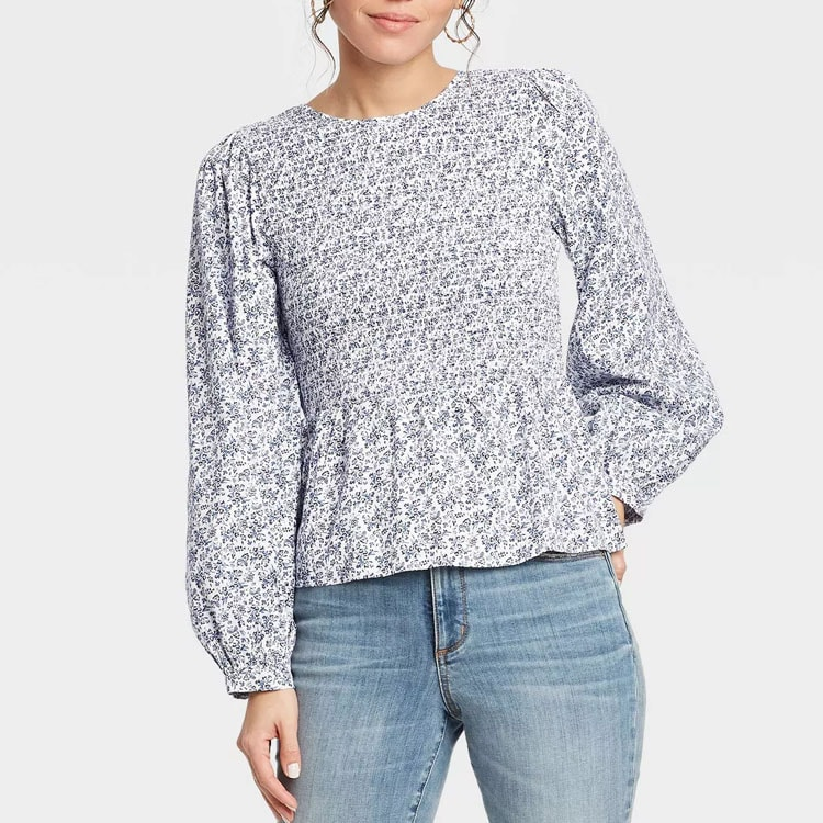 This blue floral peplum top is such a pretty spring find! #ABlissfulNest