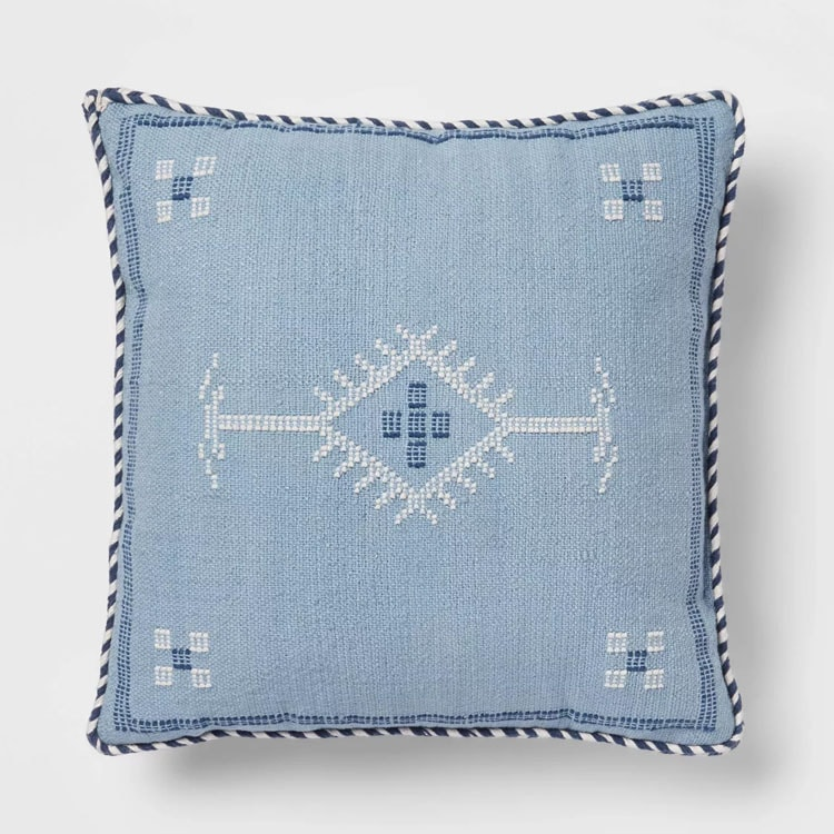 This blue embroidered throw pillow is such a fun $20 find! #ABlissfulNest