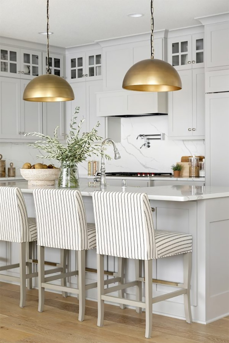 This gorgeous, bright white kitchen design by Bria Hammel Interiors is so beautiful - check out the gold accents! #ABlissfulNest