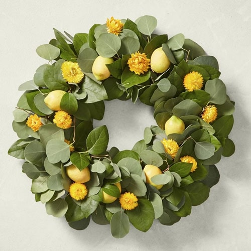 This bright lemon wreath is perfect for your front door this spring! #ABlissfulNest