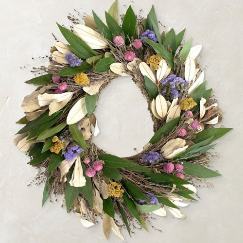 This floral wreath is so colorful and a perfect find for spring! #ABlissfulNest