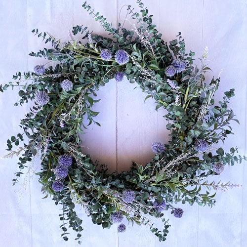This eucalyptus and globe thistle wreath is a beautiful front door wreath for spring! #ABlissfulNest