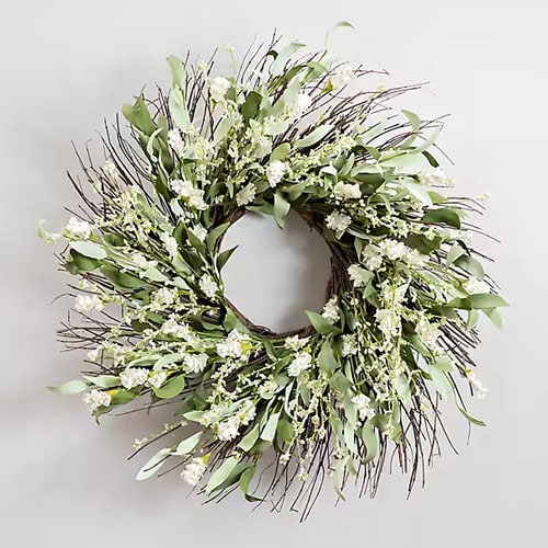 This gorgeous white wildflower wreath is a stunner for your front door! #ABlissfulNest