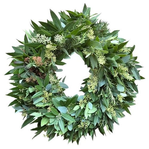 This mixed greenery wreath is such a perfect front door wreath for spring! #ABlissfulNest