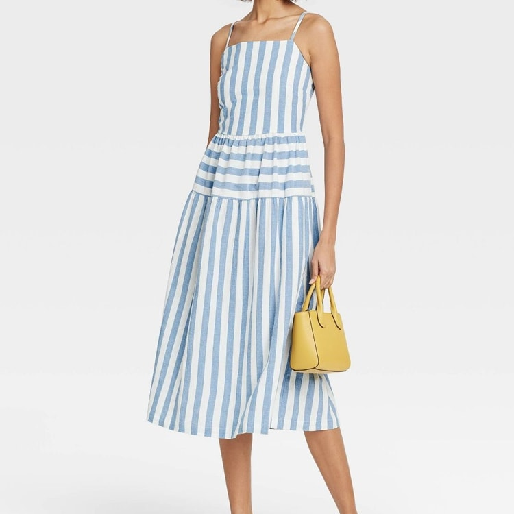 This striped tiered dress is a must have for spring! #ABlissfulNest