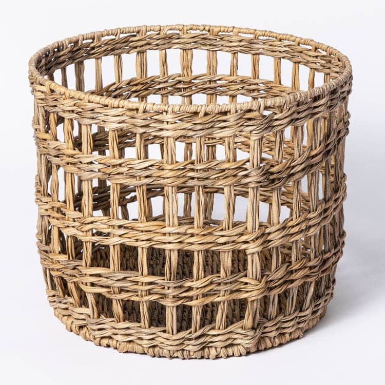 This wicker basket is perfect for outdoors (or indoors!) this spring! #ABlissfulNest
